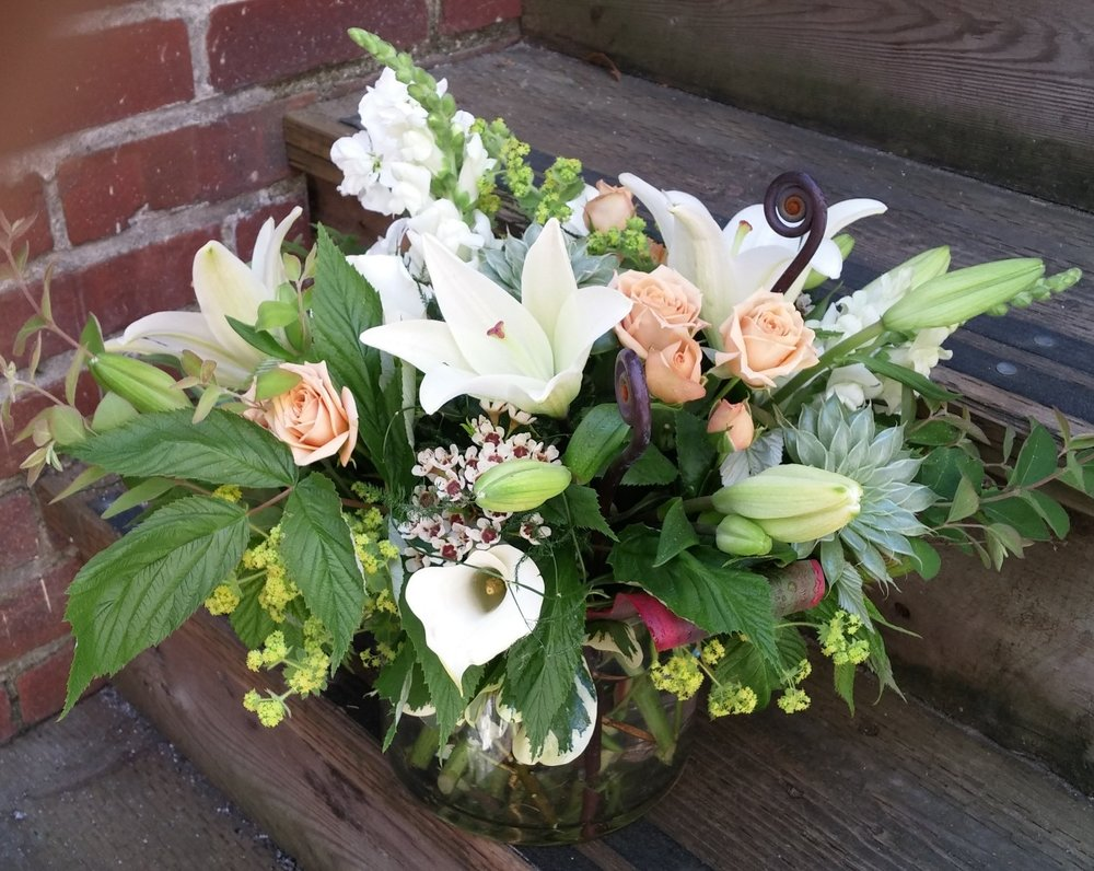 10. Lush white lily bouquet with summer foliage