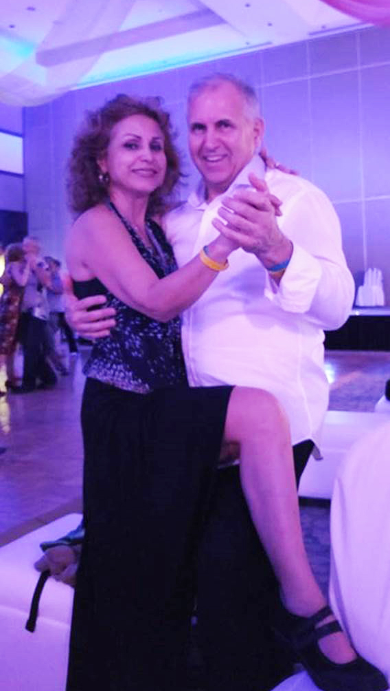 John Mafrici and his dance partner, Pari, in Cancun, Mexico