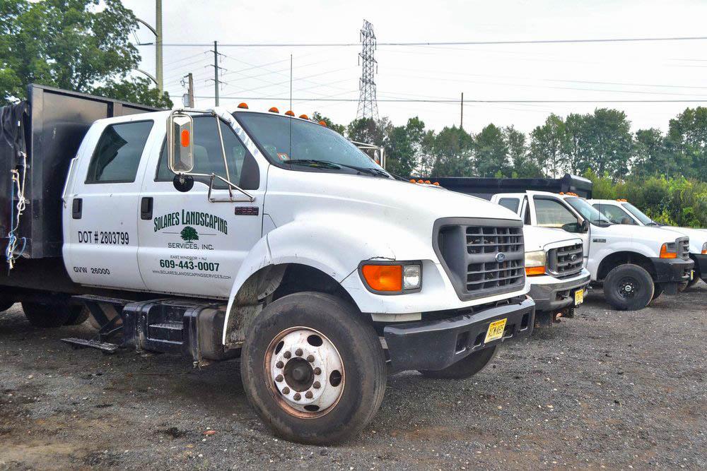 Solares Landscaping Trucks.jpg