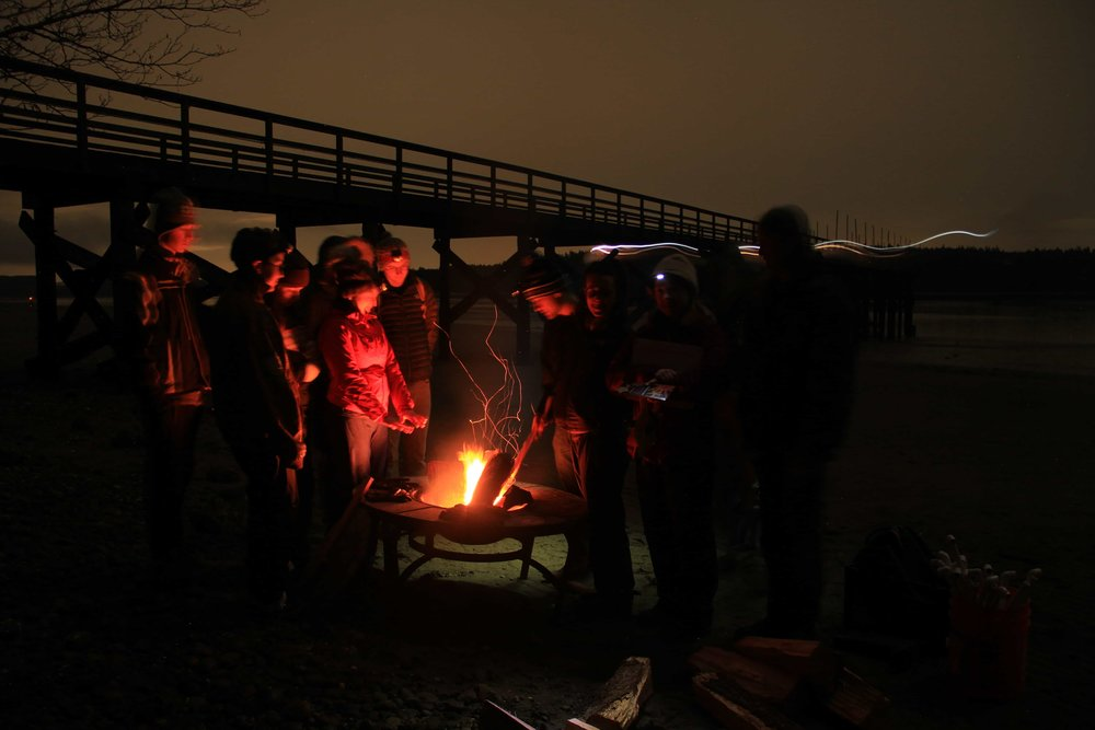 A group of happy volunteers warming themselves around the fire. Thank you to Paul Cranefield for taking all of the photos!