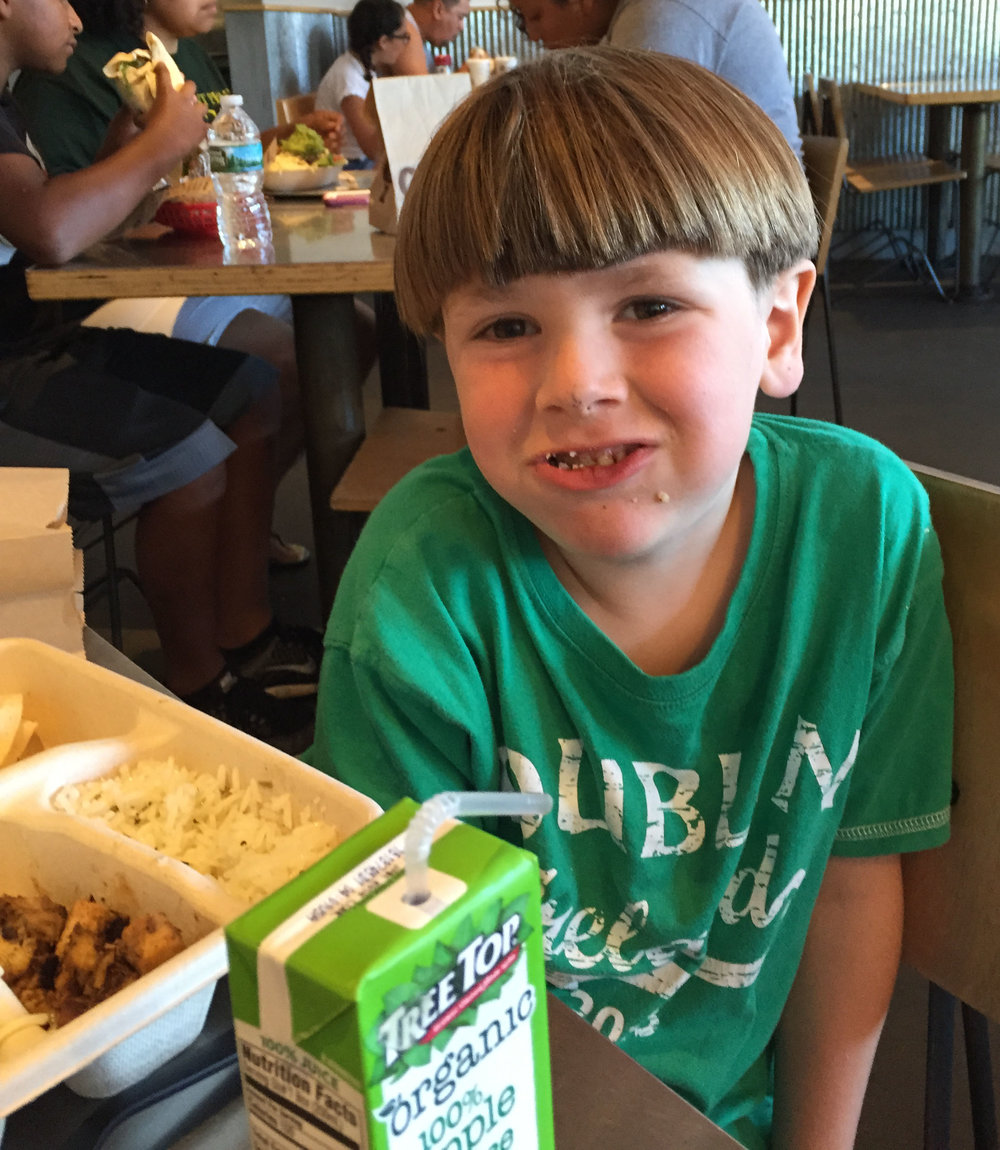 Here he is at Chipotle enjoying his free meal. This was his first time at Chipotle, and he says that he liked his meal and plans to go back. AOK--he has more gift certificates!