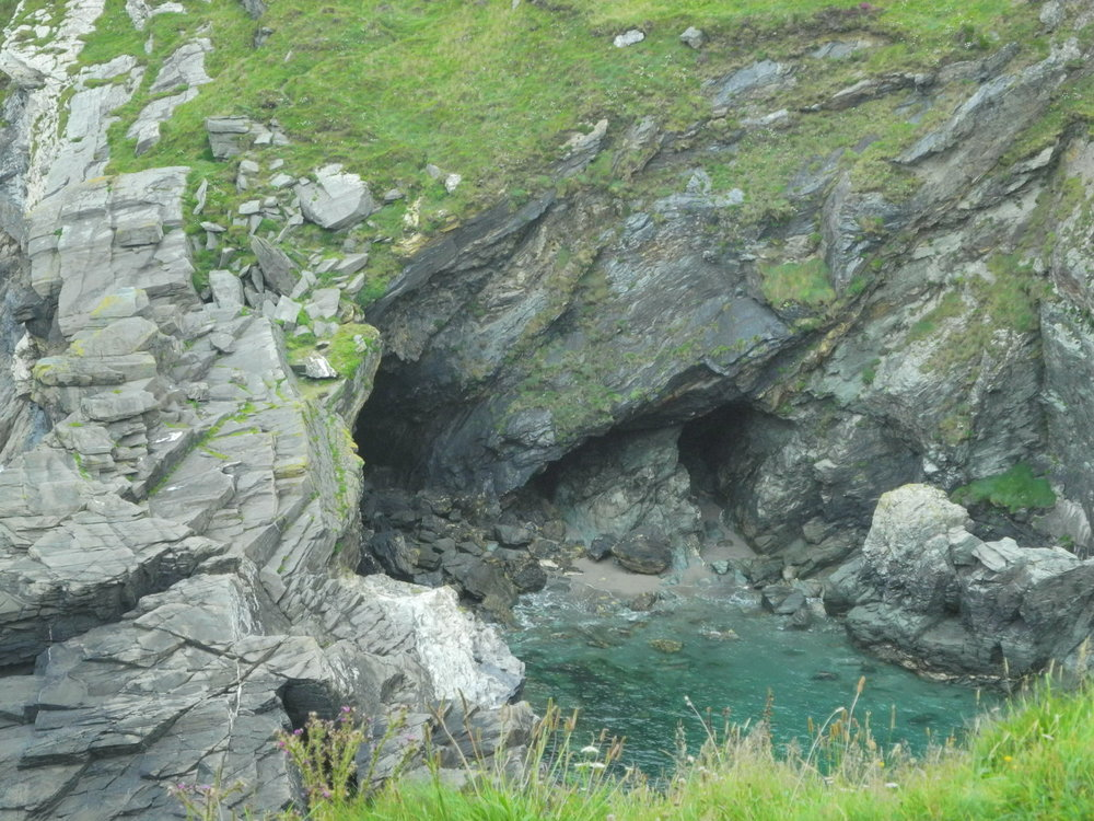 Cove and caves below Tintagel Island.
