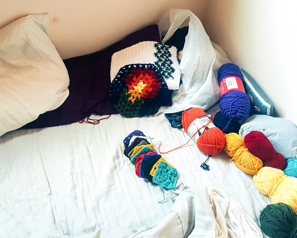 an actual image of the crocheting corner of my bed
