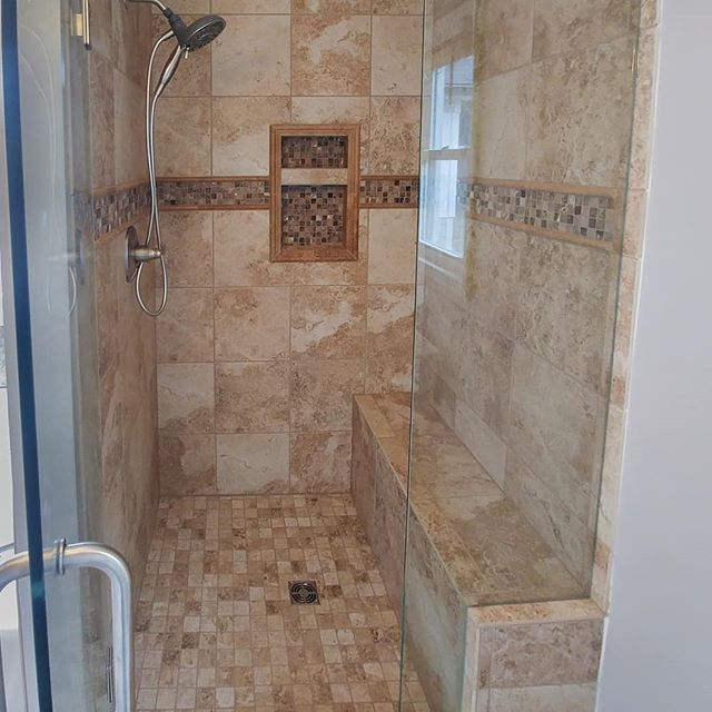 Another beauty! Special thanks to @dae222aaron for doing all of the tile setting while my broken arm heals. Also to @tilefactoryoutlet for their design assistance. We have some very happy customers!  #masterbath #renovation #remodel #shower #schlutersystems #schluter #niche #porcelain #travertine #penciltile #waterproof #showerdrain #showerbench