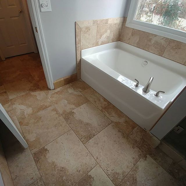 From builder-grade to custom-grade. Thanks again to @dae222aaron for stepping in to set the tile after being sidelined onto the DL!  #travertine #porcelain #tub #tubsurround #schluter #schlutersystems #base #masterbath #bathroomtile #bathroomremodel #custombathroom #remodel #renovation #tile #tilefloor #floortiles
