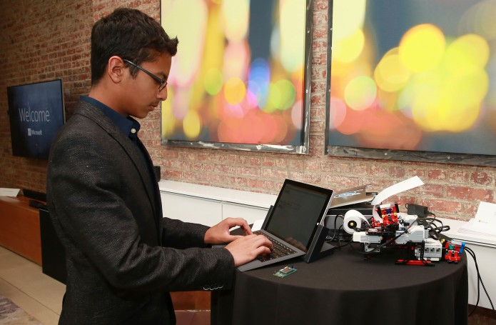 Shubham Banerjee photographed while operating his Lego-constructed Braille printer