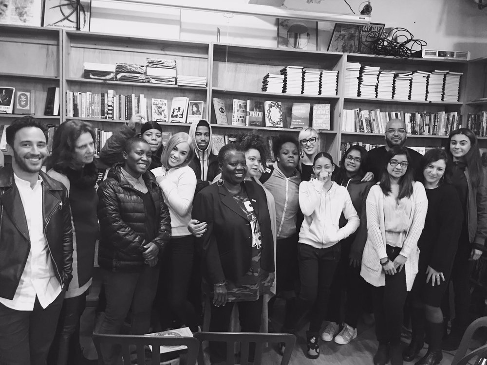 Student and mentor poets at Bluestockings Books for a reading in support of Haiti.