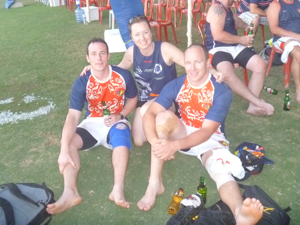 Physio Leigh with injured rugby players.JPG