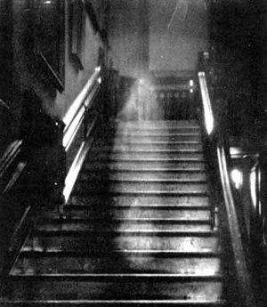 Brown Lady of Raynham Hall, a claimed ghost photograph by Captain Hubert C. Provand. First published in Country Life magazine, 1936