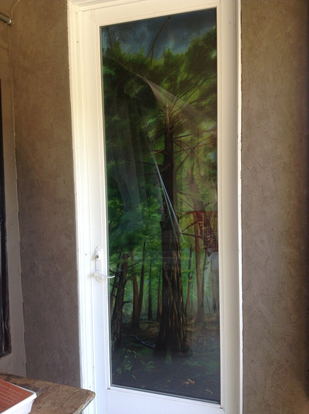 Finished piece behind glass door.