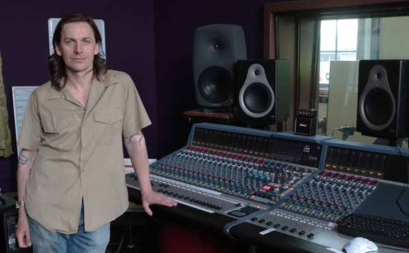 In Control Room A, Justin Phelps stands next to his Neve Genesys G48 recording console.