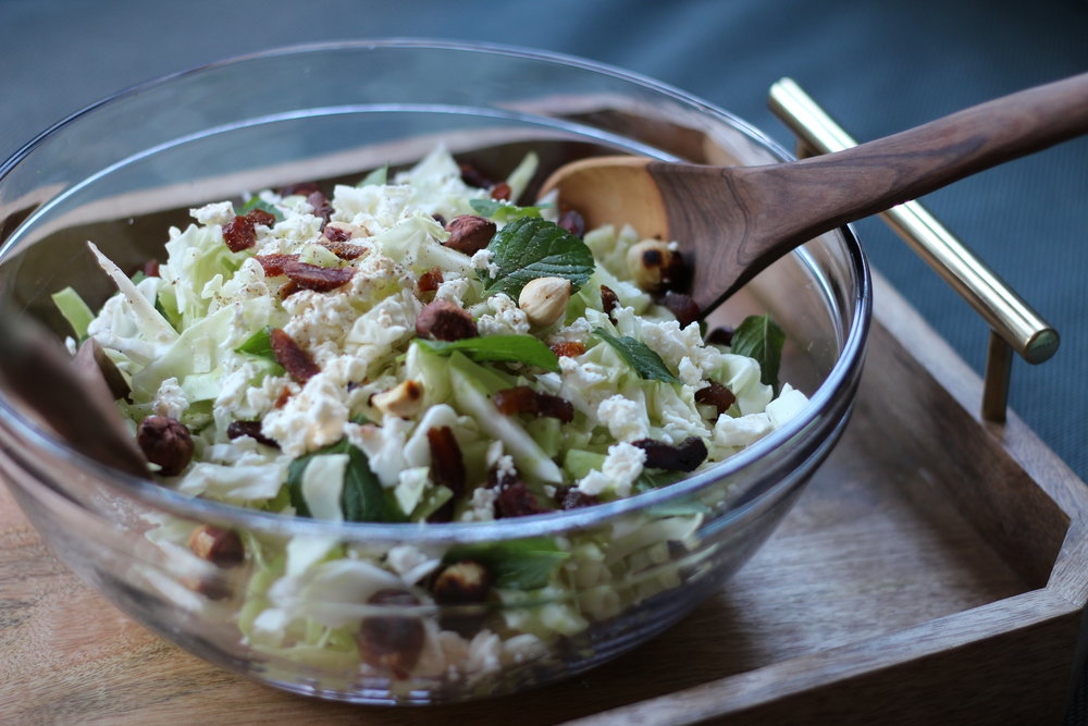 elegant cabbage salad with apricots, hazelnuts, mint, and feta