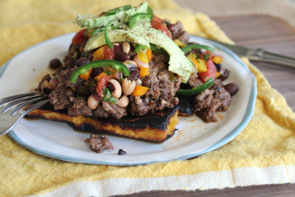 spiced beef over pan-fried plantains topped with cowboy caviar and avocado*    PLEASE NOTE: This dish is more complicated to make + has a side dish already built in, so if you choose it, we will make a simple green salad instead of having you choose from one of the salad/side choices above