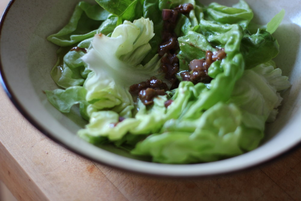 butter lettuce salad with signature sizzled shallot vinaigrette, goat cheese and toasted nuts