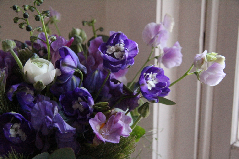 Purple delphinium and sweet peas