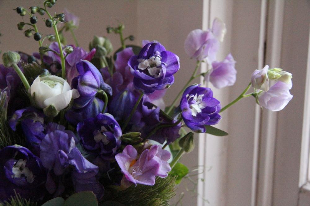 Purple delphinium and sweet peas