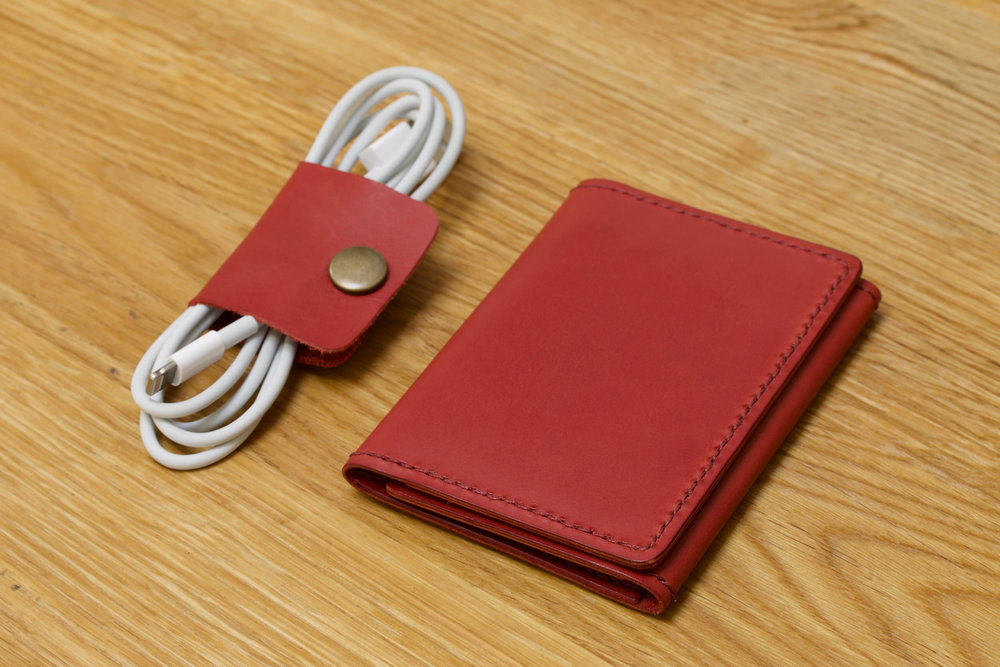 Cable clip and tri-fold card holder, Vermilion Red