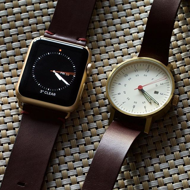Apple Watch 42mm gold aluminium and a Void V03D gold/off-white, both paired with custom straps made from our Espresso Crispin leather. The dark brown works so well with gold faces, and the minimal Oxblood stitching adds a fleck of colour to the #applewatch. ⌚