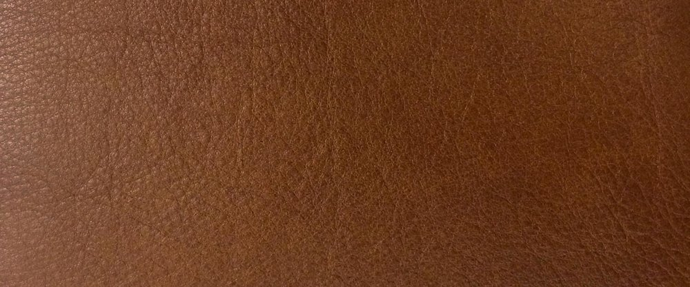 CLASSIC BROWN - Soft and pliable, this calf leather is a constant shade of mid-brown. It is milled for a smooth tactile grain pattern.
