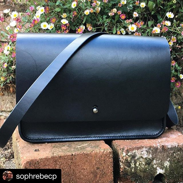 A bespoke bag made for @sophrebecp from our dark black leather and hand stitched with black thread. We're always open to bespoke projects, so drop us an email to discuss! ・・・ Overjoyed with this bespoke beauty ❤️ @matthew.sime @outlineleather  #satchel #leather #handmade #leathergoods #madeinbritain #classic #instabags #bespoke #flowers #bags #bag