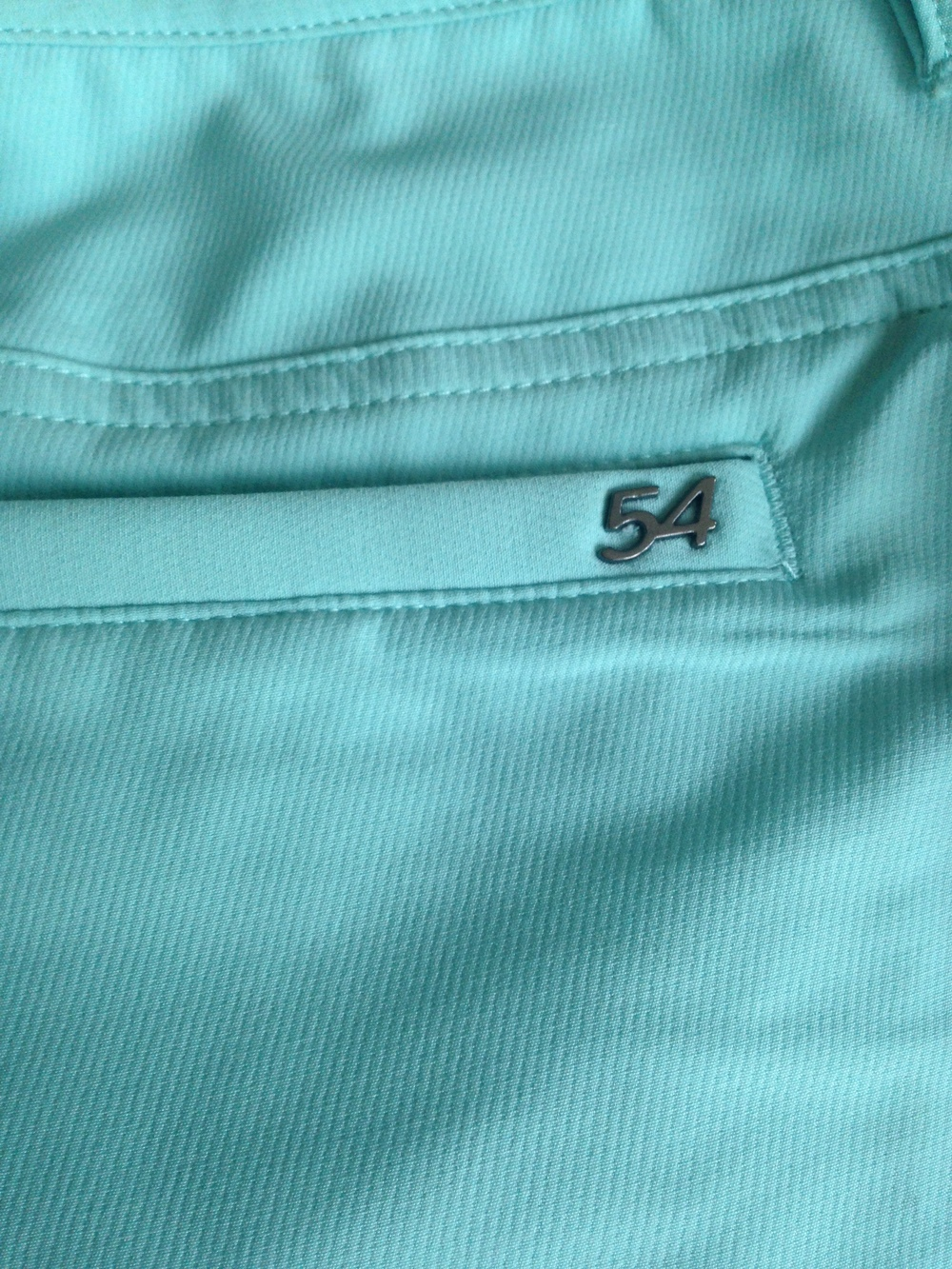 The Chase54 logo on the back pocket of the Dalton Shorts