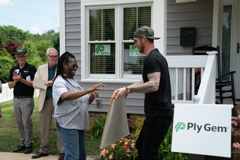 serving as Ply Gem Home for Good project regional ambassador, brett young, the academy of country music awards' new male vocalist of 2018, presents the owner of a newly renovated home with a welcome mat on may 8th.