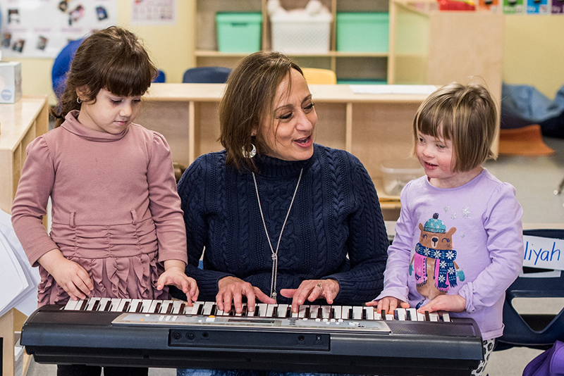Nay, age 5, and Aubrey, age 5, participate in music therapy with therapist Paula Scicluna.