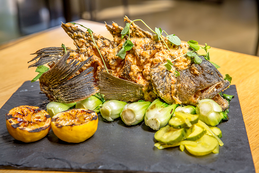 Whole Fried Fish (black sea bass local to nc) whiskey kitchen. image courtesy of Stacey Sprenz / Tabletop Media Group