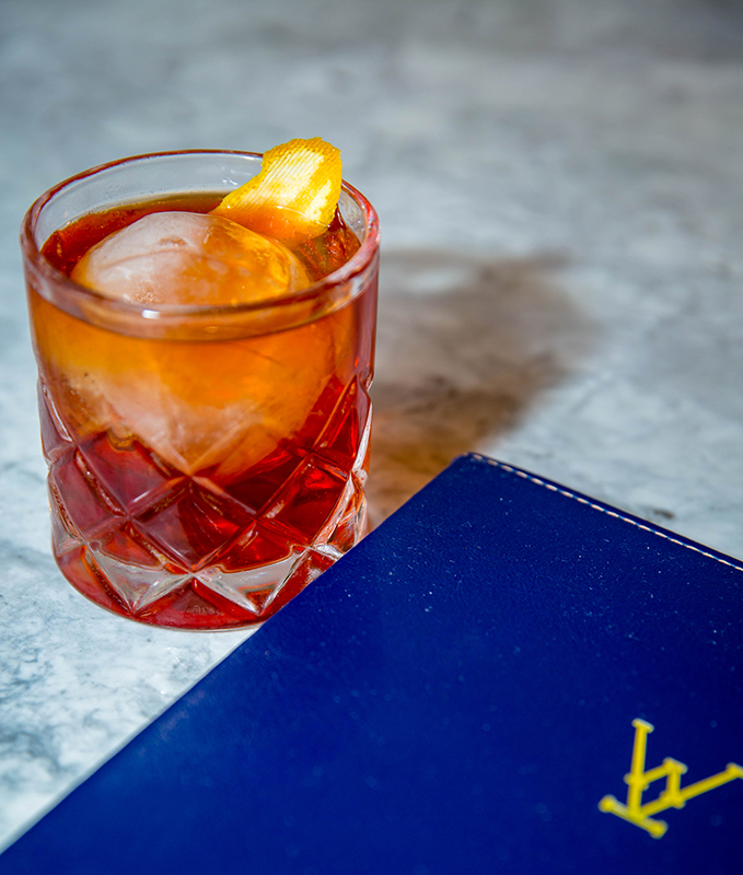 Negroni at whiskey kitchen. image courtesy of Stacey Sprenz / Tabletop Media Group