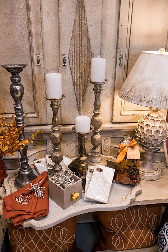 Caspari gold marble napkins, $4.99–$6.99; Autumn cloth table napkins $7.99 each; Napa garden sparkle bead napkin rings, $5.99 each; Sullivan's gold candleholders, $39.99–$49.99; LED candles, $29.99;  Lloyd & Lady Boutiques  8847 Six Forks Rd; lloydandladync.com
