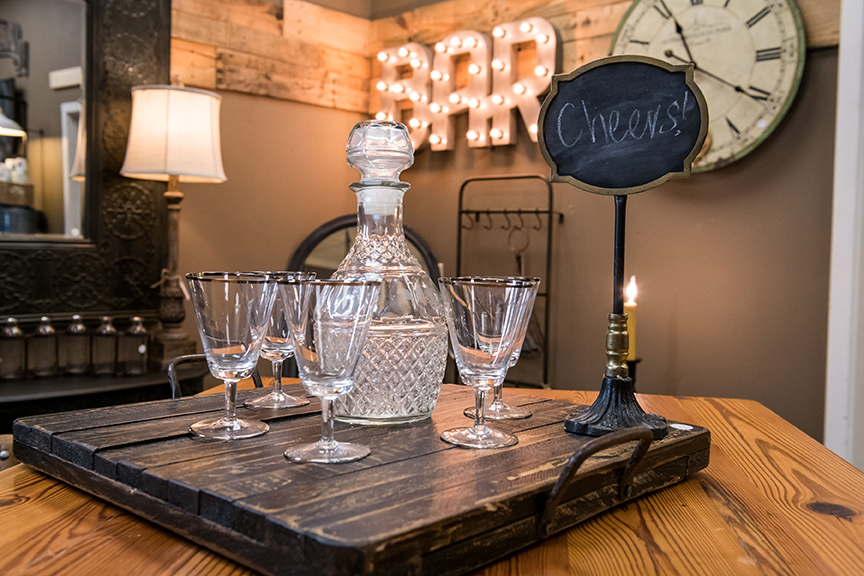 'Bar' Marquee, $225; Bar cart, $995; Crystal decanter, $18; Set of 5 glasses, $16; Chalkboard, $16; Wood Tray, $42;  revival antiques  1505 Capital Blvd #14; revival-antiques.com