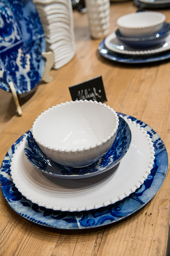 Costa Nova soup bowl, $21.85; Costa Nova pasta plate, $36.80; Costa Nova chargers, $59.80 each; Costa Nova chalkboard w/ easel, $2.74;  steven shell living ; 2030 Clark Ave; stevenshellliving.com