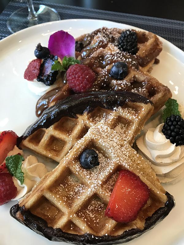 so•ca  Churro Waffles with orange chocolate ganache, dulce de leche, espresso whipped cream, fresh berries