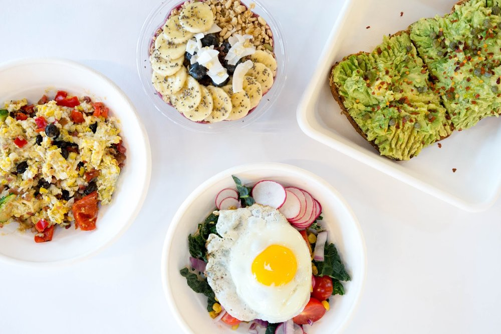 Happy and Hale food served in compostable bowls and plates.