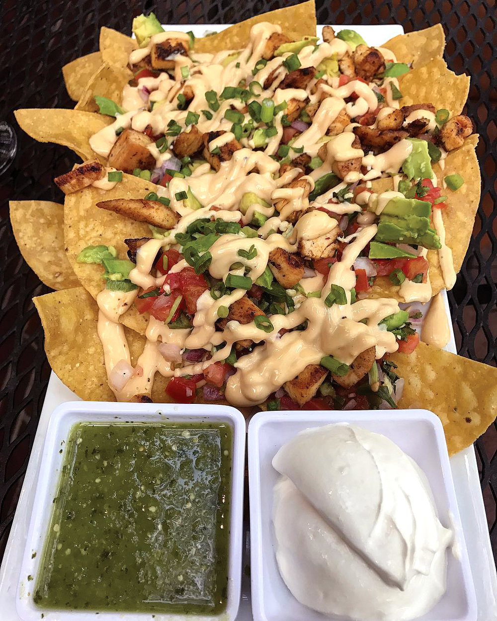 CLOUDS BREWING  Chicken Nachos with beer cheese, pico de gallo, and fresh avocado + sides of salsa verde and sour cream