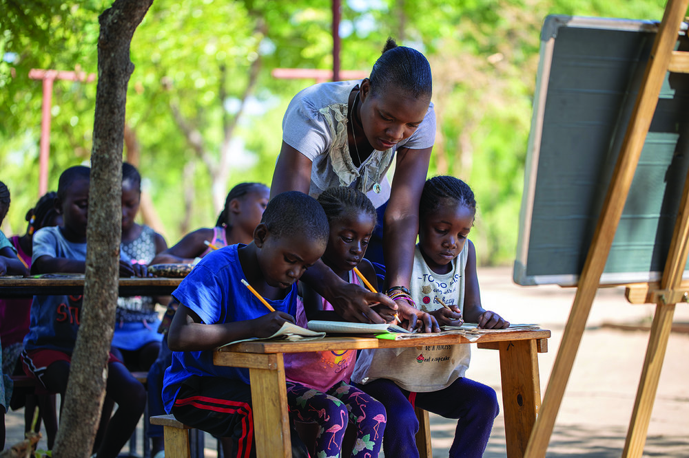 Life Okendewa's private tutor, Ida, teaches the children three afternoons a week.