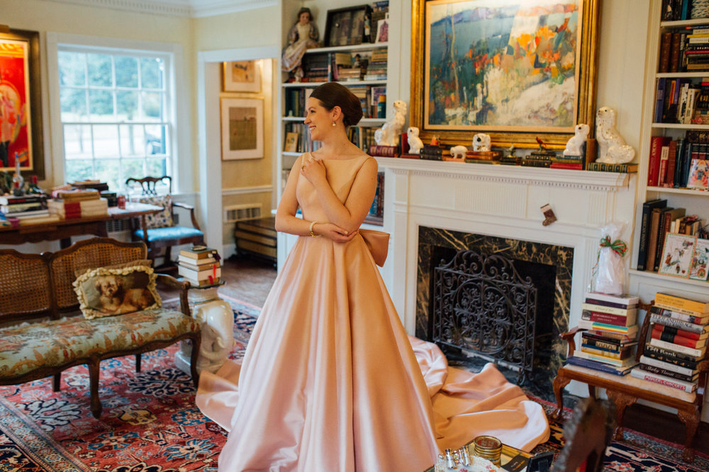 """My mother, sister, and I were about to leave Alexia's Bridal Boutique in Raleigh when Penelope pointed out """"this pink one."""" The moment I put it on I knew it was the right dress for me. It's modest, classic, and traditional, but also exciting. My skin tone is so pale, and the color of the dress complimented it perfectly. I walked out of the store about an hour later having bought my Sareh Nouri dress and a veil.  —ISABELLA"""