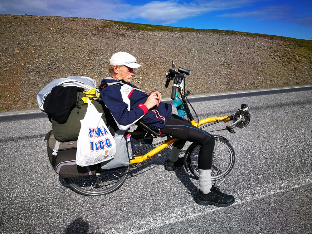 """This 63 year old. Man had been biking from Netherlands to The North Cape and now he was heading back to Amsterdam. """"Chapeau!"""""""