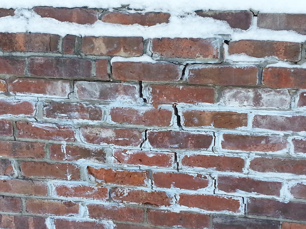Water makes its way into the cracks and pores, freezing and thawing wreaks havoc on building structures.