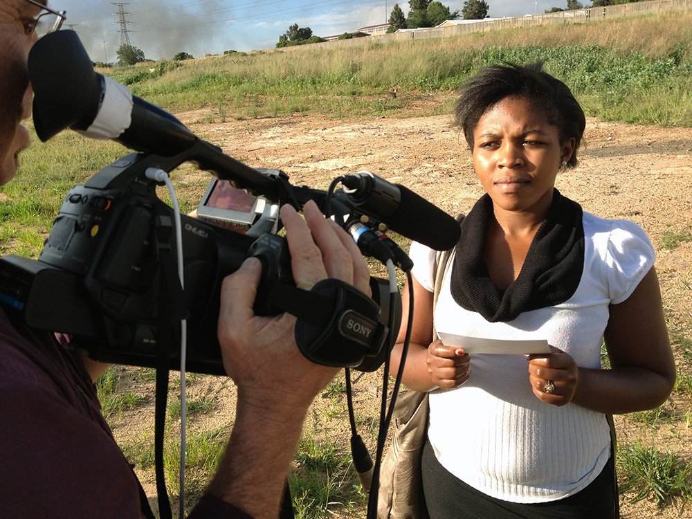 A young woman being interviewed in Soweto