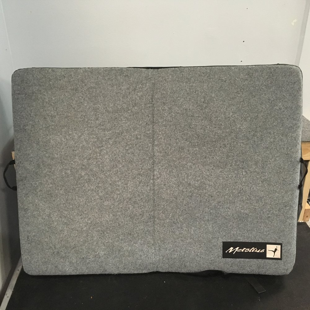 "Metolius's Session crash pad is a versatile, do-it-all pad featuring flap-closure-system with stash pocket keeps your gear secure, while burly 900d poly outer fabric protects your pad from abrasion. Retail for the pad is listed at $150 but we can get you bouldering for $64! The open size is 36"" x 48"" x 4"" and weight is listed at 9lbs."