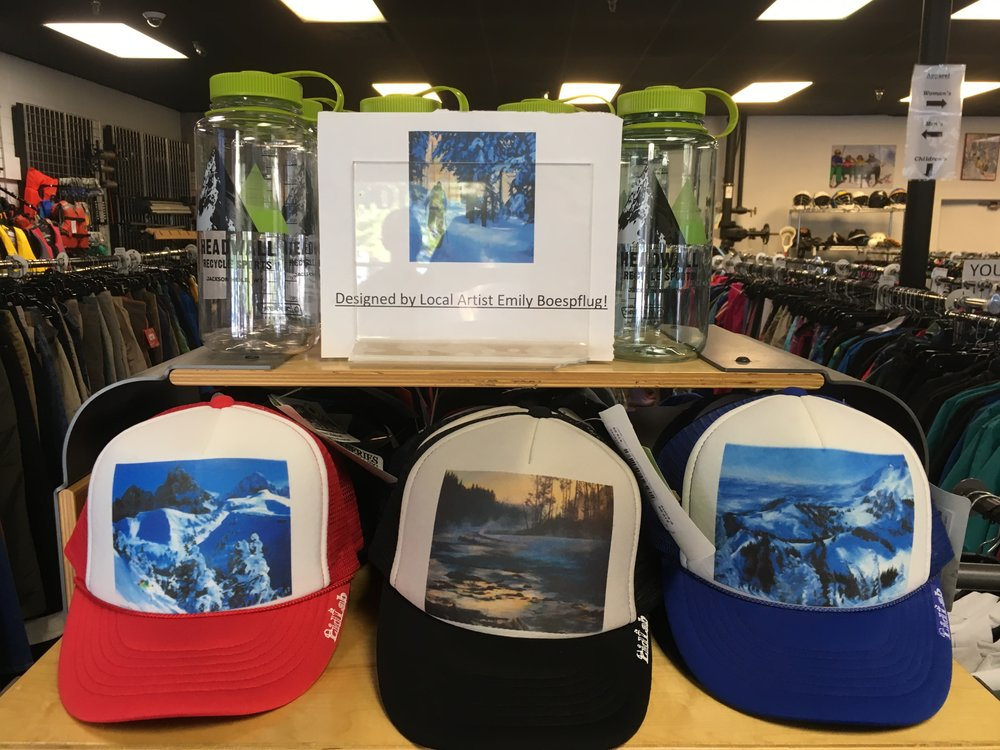 We have local artist, Emily Boespflug's, hat designs for $20! There are a lot of colors and designs so come in and check them out!