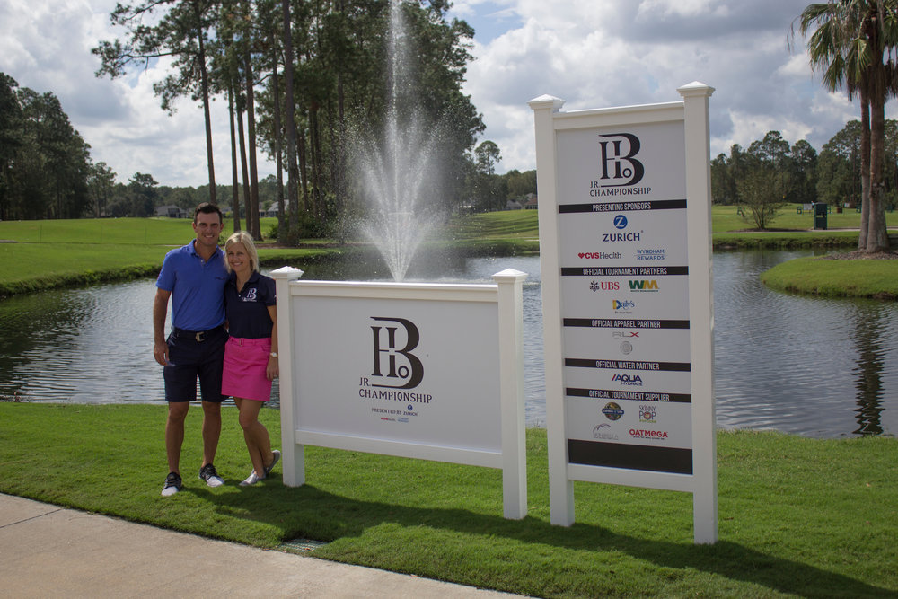 Billy and Brittany Horschel with Tournament signage - 2017 - Billy Horschel Junior_1.jpg