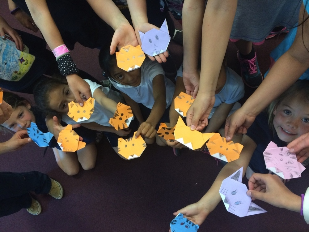 Youth learned to fold multi-colored origami tigers with Marisa