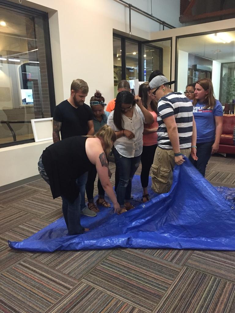 Participants doing a team-building activity at PSERP workshop