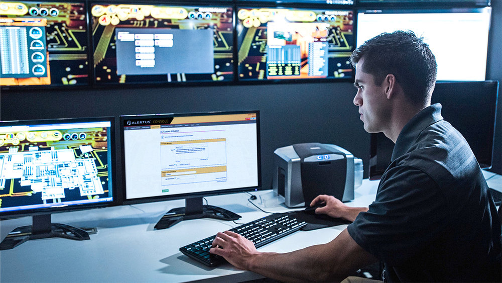 alertus_console_command_security_guard_watching_monitors_in_control_room_1200x678_web.jpg