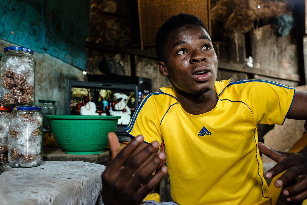 "Soon after completing his photographic course, Komi Nblasso, 23, got his first loan from IADES (Deki's partner in Togo) and dreams of becoming Official Photographer to the President. Without the money to buy a camera (he estimates he can get one for about £660) Komi views his first loan of £66 as just the start. Explaining how he takes people's pictures using his boss's camera, framing them with frames purchased by his loan, his entrepreneurial spirit is clear to see. ""I repaid my loan last Friday,"" he says with a grin. ""I am already planing on applying for another."" [Pictured May 2017]."