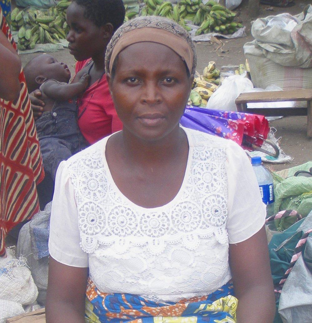 Stella at the Mpondwe Lhubiriha Town Council market, selling Gonja