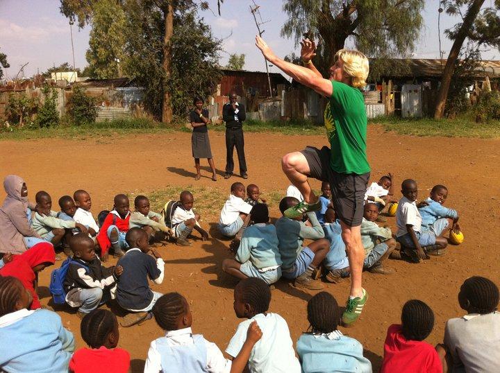 Emile teaching Aussie Rules skills in Kenya to students