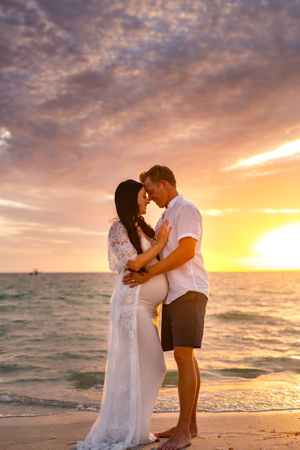couples maternity pictures on the beach, st Pete fl